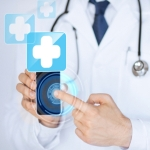 doctor holding smartphone with medical app