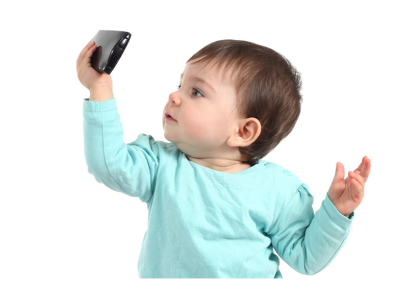 baby watching a mobile phone guiding parents of small children regarding optimal - Pictures Of Small Kids
