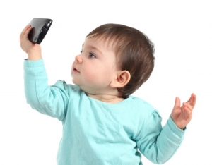 Baby holding phone