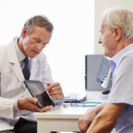 Doctor showing patient tablet